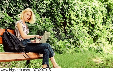 Girl Adorable Student With Laptop And Coffee Cup Sit Bench In Park. Study Outdoors. Woman Student Wo