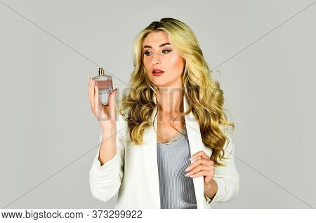 Sensual And Unusual Combination. Attractive Woman Hold Perfume Bottle. Girl Long Curly Hair Satisfie