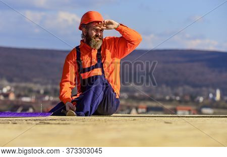 Man Roofing Surface. Professional Master Repair Roof. Flat Roof Installation. Roofer Constructing Ne