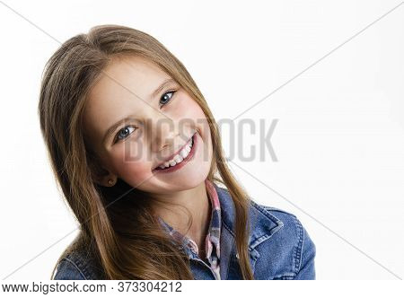 Portrait Of Adorable Smiling Little Girl Child Preteen Sitting Isolated On A White Background