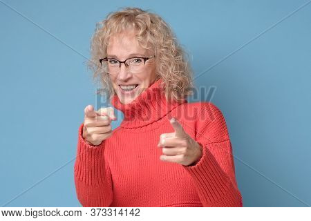 Senior Woman Pointing You, Saying You Are Great.