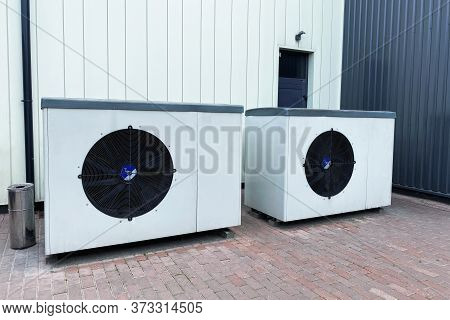 Industrial Fan Turbine Background. Air Conditioner Condenser Fan Units Battery Set Climate Control.