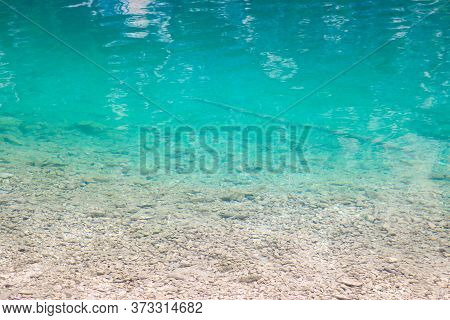 Beautiful Clear Cold Clear Water In A Lake Or River In The Mountains