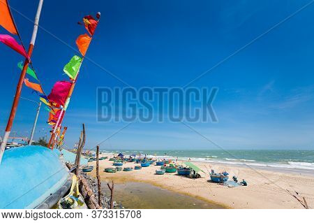 Summer Seascape With Ke Ga Lighthouse In Vietnam. Landscape Taken From The Beach With Blue Sky On Th