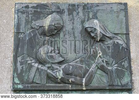 Sint Gillis Waas, Belgium, July 9, 2019, Bronze Panel With Green Patina Represents The Descent Of Th