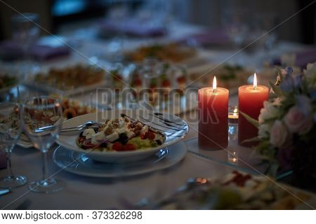 Delicious And Beautifully Decorated Candlelight Dinner For Guests