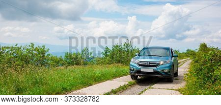 Mnt. Runa, Ukraine - Jun 22, 2019: Cyan Honda Cr-v Suv On The Mountain Road. Explore The Wilderness
