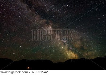 Night Panorama Of The Starry Sky With The Milky Way Galaxy, Stars, Nebulae And Meteors In The Mounta