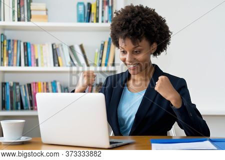 Cheering African American Business Trainee Working At Computer Indoors At Home Or At Office