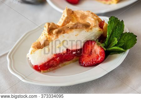Slice Of Delicious Strawberry Tart With Meringue On Wooden Background. Summer Food