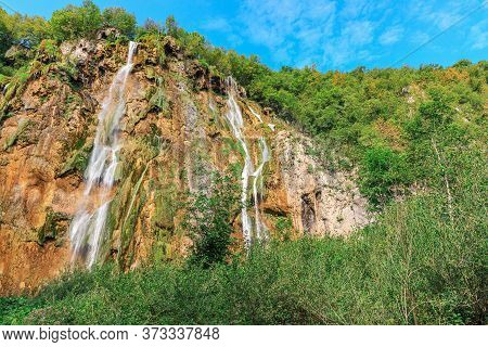 Landscape Of Waterfall Among Rocks In The Forest. Plitvice Lakes National Park, Croatia. Nacionalni