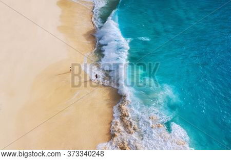 Beach, People And Waves. Coast As A Background From Top View. Blue Water Background From Drone. Summ