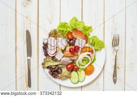 Vegetables Salad On Dish On White Wood Table