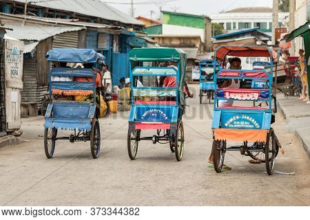 Toliara, Madagascar - January 10th, 2019: Rear View Of Three Cycle Pousse Pousse At The Commercial C