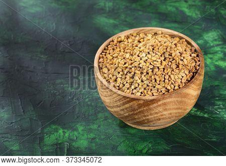 Trigonella Foenum - Graecum. Fenugreek Seeds. Wood Background