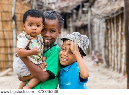 Andavadoaka, Madagascar - January 13th, 2019: Three Local Malagasy Boys Outdoors In The City Center