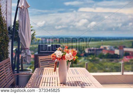Summer Flower Bouquet In Vase On Rooftop Patio