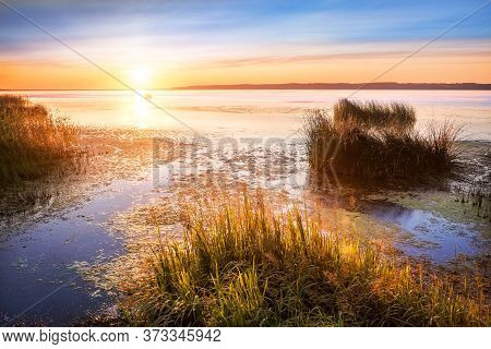 Beautiful Summer Landscape With A View Of Lake Galich In The Kostroma Region And The Setting Sun Wit