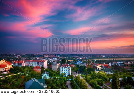 Beautiful Sunset Light Have Painted The Sky And The City Down In The Valley In Pink Colours. Uzhhoro