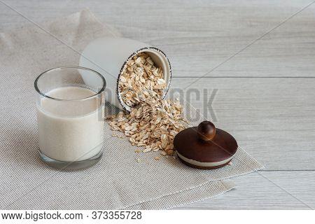 Vegan Oat Milk, Non Dairy Alternative Milk In A Glass With Oat Seeds