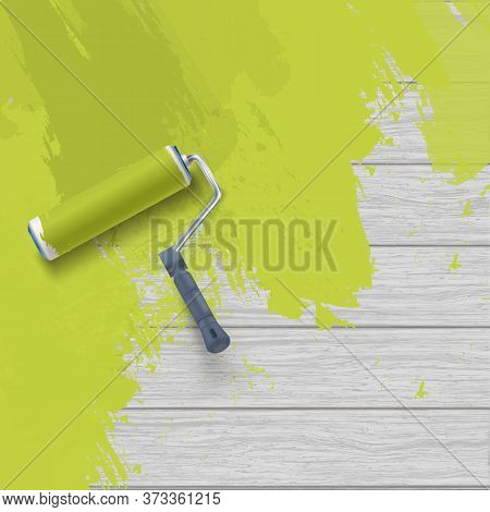 Painting Wooden Wall With Roller Brush And Green Paint