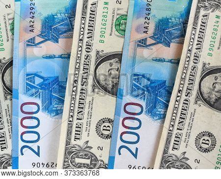 Us Dollars With Russian Rubles, Background. Financial Crisis, Ruble Devaluation Concept.