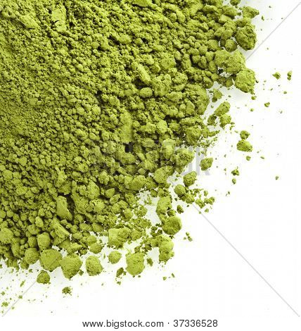 powdered green tea isolated on white background