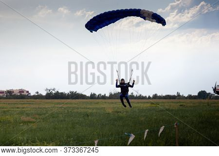 Kyiv, Ukraine - June 21, 2020: A Parachutist With A Parachute Jumped And Flew. Fly With A Parachute.