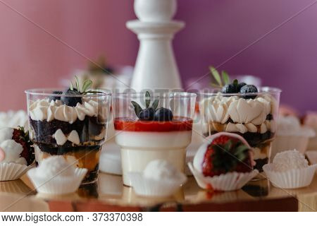 Closeup Desserts In Glass Decorated With Blueberry And Mint. Panna Cota. Dessert. Dessert Table