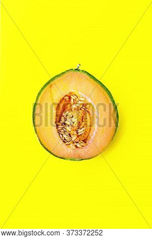 Honey Melon Or Cantaloupe Cucumis Melo. One Half Of Japanese Melon On Yellow Background. Summertime