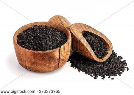 Nigella Sativa Or Black Cumin In Wooden Bowl Isolated On White Background