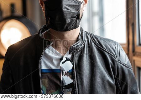 Young Man In Protective Face Mask As Preventive Measure From Coronavirus Covid-19. Personal Protecti