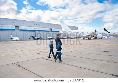 Family Walking To Business Jet