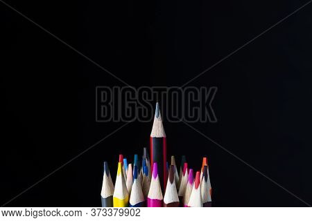 Color Pencils On A Black Background, White, Shallow Depth Of Field. Education Concept, First