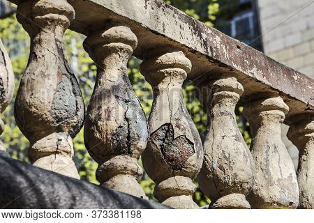 Old Stone Balusters At Sunny Rays In Day