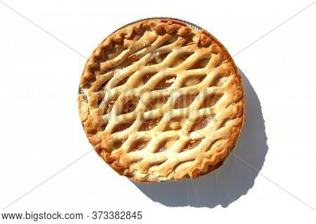 Apple Pie. Fresh Baked Apple Pie. Isolated on white. Lattice top Apple Pie. Whole Fresh  Baked Pie in an Aluminum pan.