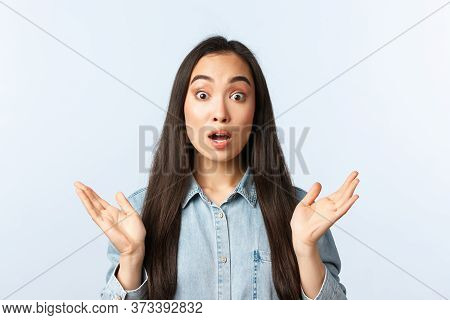 Lifestyle, People Emotions And Beauty Concept. Shocked And Surprised Korean Girl Clasp Hands And Gas