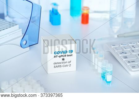 Quick Novel Covid-19 Coronavirus Test Kit. 2019 Ncov Pcr Diagnostics Kit. Hand In Glove With The Box