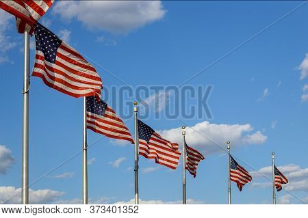 Washington Monument American Flags Blowing In The Wind At In District Of Columbia Dc Usa