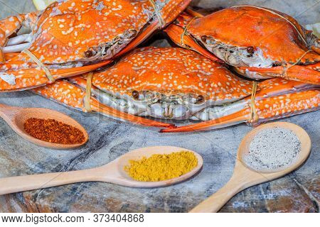 Jumbo Crab And Spices Herb On Dark Background..