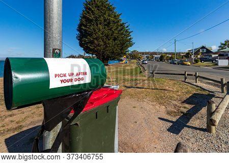 A Dog Waste Bag Dispenser At The Waterfront Of Bell Bay, Tasmania, Australia.