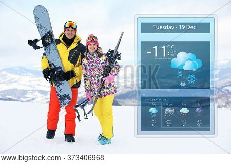 Lovely Couple With Equipment At Ski Resort And Weather Forecast Widget. Mobile Application