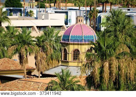 June 22, 2020 In Palm Springs, Ca:  Historical Building With A Spanish Style Dome Surrounded By Palm
