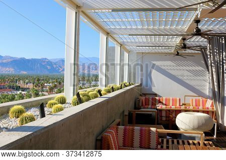 June 22, 2020 In Palm Springs, Ca:  Outdoor Cabana Patio Furniture Besides Barrel Cacti Surrounded B
