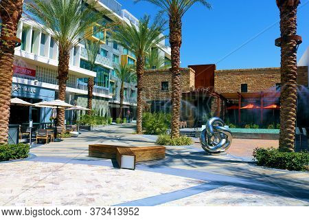 June 22, 2020 In Palm Springs, Ca:  Contemporary Style Outdoor Courtyard With Restaurants Besides A