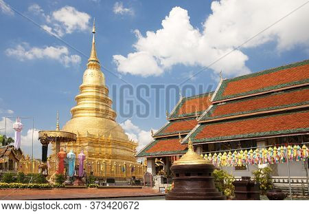 A Golden Pagoda At Wat Phra That Hariphunchai In Lumphun Province, Thailand After The Most Recent Re