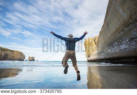 Jumping man above calm lake