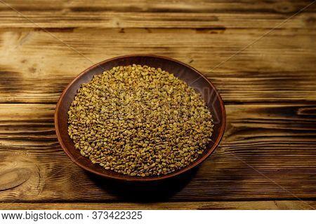 Fenugreek Seeds In Ceramic Plate On Wooden Table