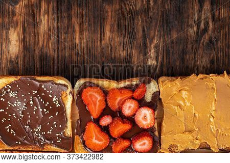 Assortment Of Sweet Sandwiches With Chocolate Paste, Peanut Paste And Fruit Slices