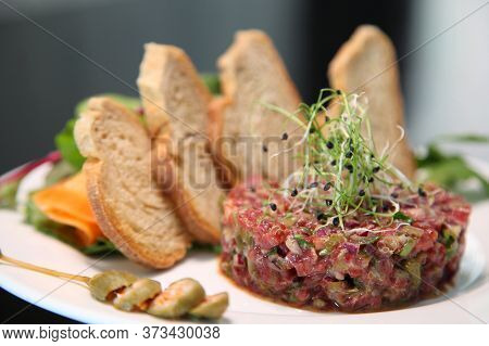 Raw Tartar Meat With Spices, Croutons And Herbs. Beef Tartar With Capers. Beef Tartar With Slices Of